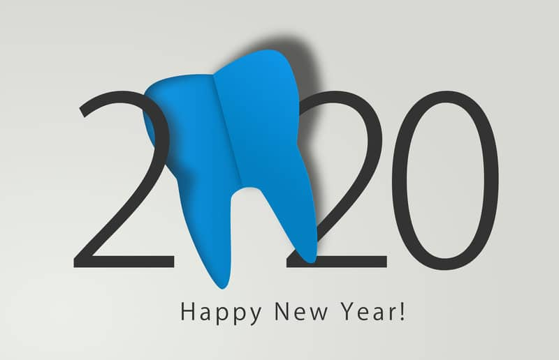 """Picture of """"2020"""" with a tooth as the zero and the saying """"Happy New Year"""" underneath."""